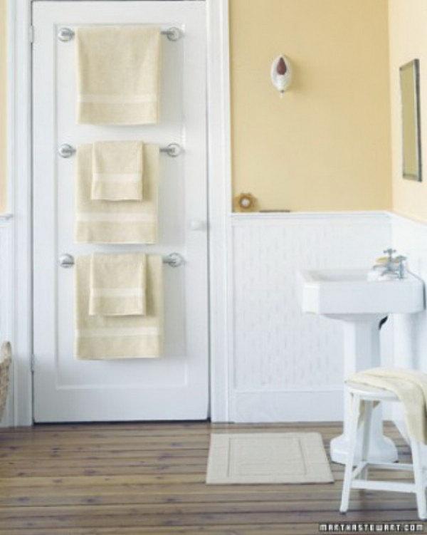 Hang Towel Holders Behind Bathroom Door For More Storage Space.