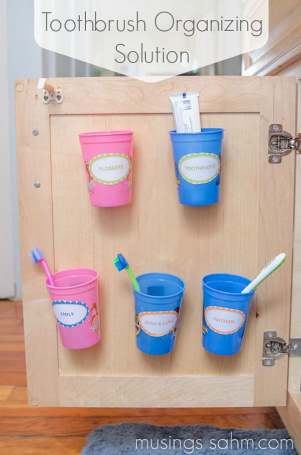Install These Cups Behind The Cabinet Door To Organize Your Toothbrushes.