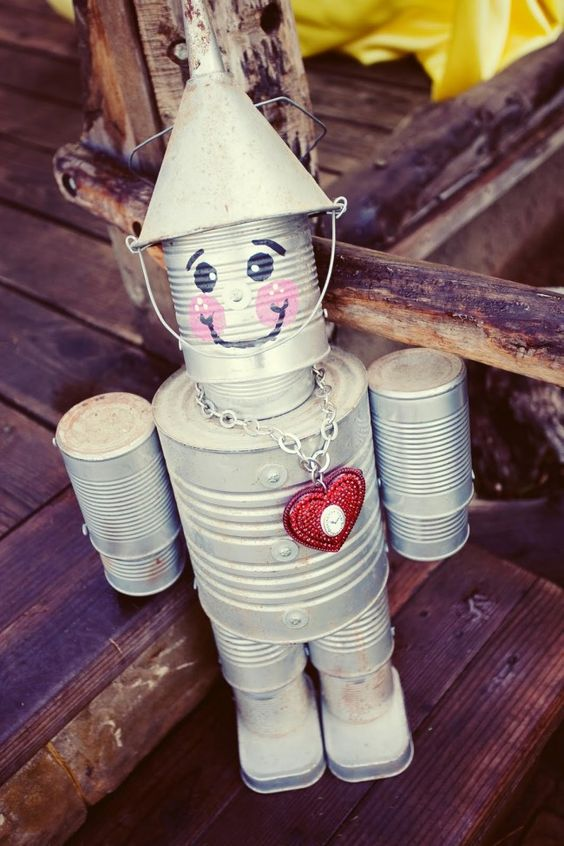 Add Color and Joy to Your Garden with This Tin Can Man.