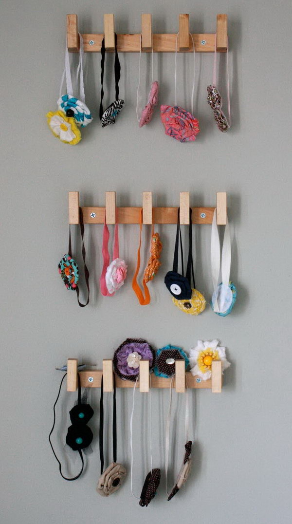 Use Wall-Mounted Rack To Keep Headbands Separated By Size