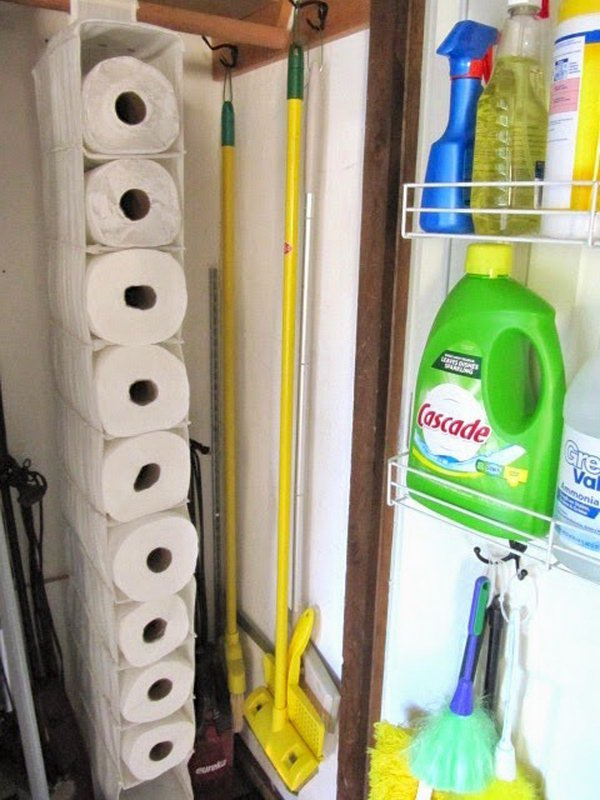 Use A Hanging Shoe Organizer To Hold The Unused Paper Towels