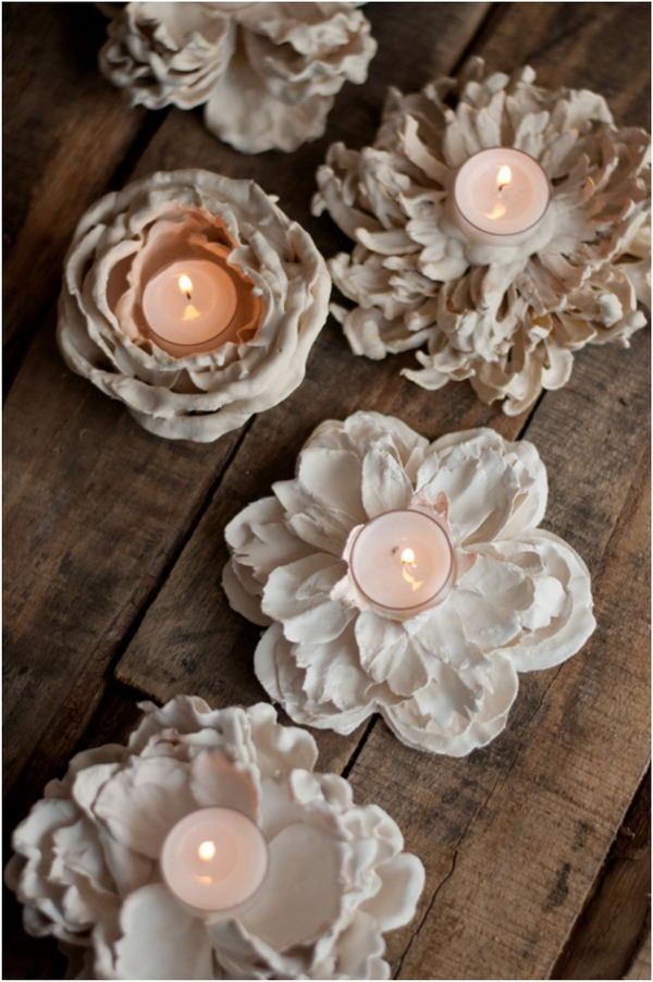 DIY Romantic Plaster Dipped Flower Votives. I can't believe how easy it is to make these beautiful flower votives at home. Tutorial via
