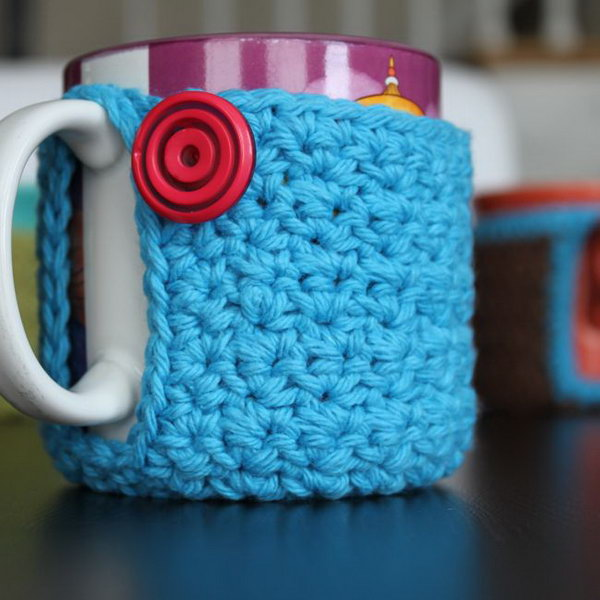 Crochet Mug Cozy. A crochet coffee cozy is a knitted piece that wraps around a coffee cup. It provides extra insulation, keeping coffee in cups warm while protecting fingers from the heat.