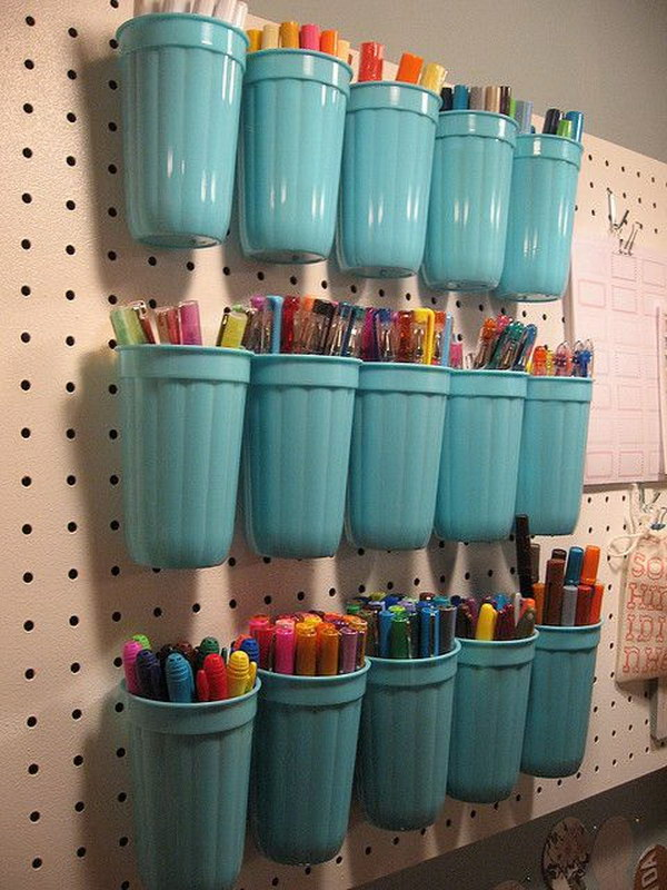 Plastic Cups on a Pegboard.