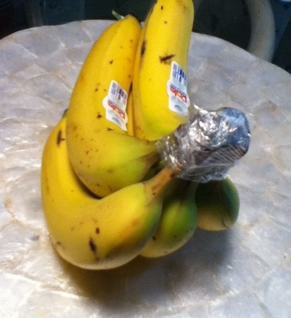 Wrap the crown of a bunch of bananas with plastic wrap. They'll keep for 3-5 days longer than usual.