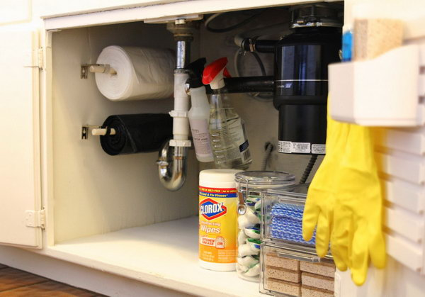Store trash bags on a roll under the sink to keep them accessible.