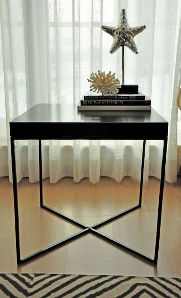 This creative welded table was made with the wood tabletop from an IKEA LACK table and the X-shaped metal frame as the table legs.