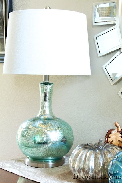 IY Mercury Glass Lamp. A little mercury glass spray paint makes a thrift store lamp get a gorgeous and expensive look.