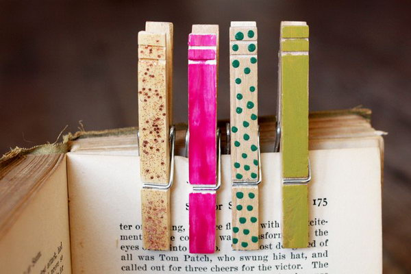 Use nail polish to paint some wood clothes pins.