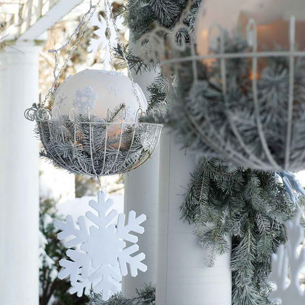 Elegant Hanging Baskets with Frosted Evergreen Branches and Sparkling Accents