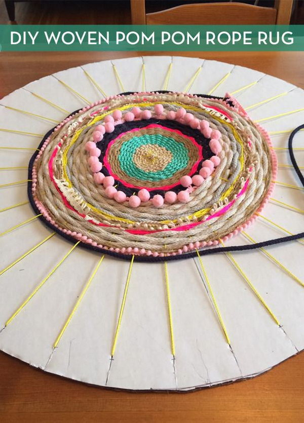 Woven Rug using a Cardboard Loom. Detailed tutorial on how to make a pretty rug from old t-shirts, on a cardboard loom or hula hoop loom!