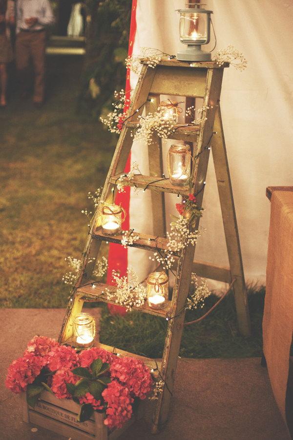 Rustic Ladder Decorated With Mason Jar Lights.