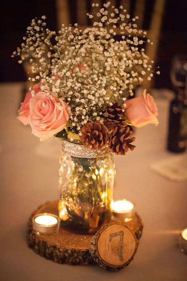 45 awesome diy wedding centerpiece ideas and tutorials 2017 stunning rustic mason jar centerpiece with pine cones candles and wooden table number junglespirit Choice Image