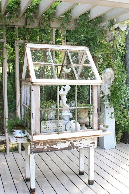 DIY Greenhouse Made Out of Old Windows.