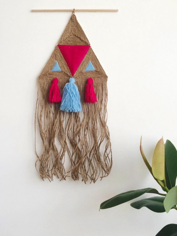Rustic  Wall Hanging Made out of Jute Twine and Yarn.Learn to make these very simple wall hanging. Perfect for those without a lot of time on their hands!  Tutorial via