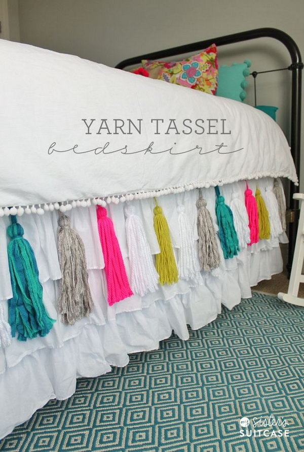 DIY Yarn Tassel Bedskirt. This is such a pretty idea to add some pop to your bedroom with this DIY yarn tassel bedskirt! I really love the custom look. Tutorial via