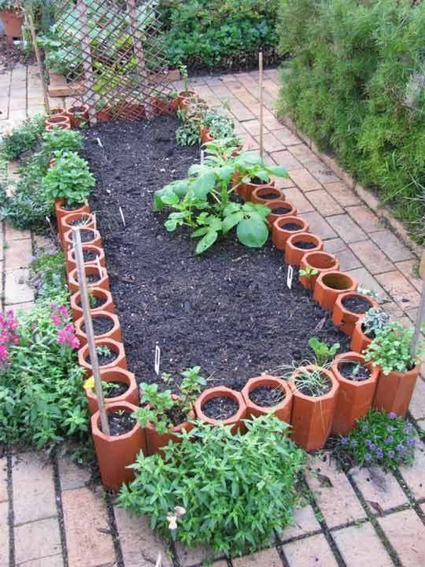 DIY Raised Garden Beds from Old Terracotta Pipes.