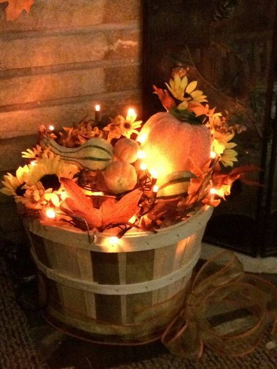 Fill a Basket with Leaves and Christmas Lights for Fall Porch Decor.